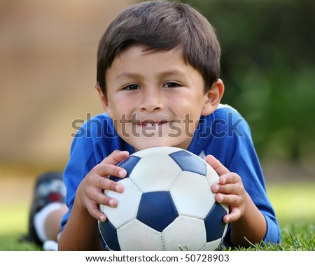 Young hispanic boy with soccer ball - stock photo