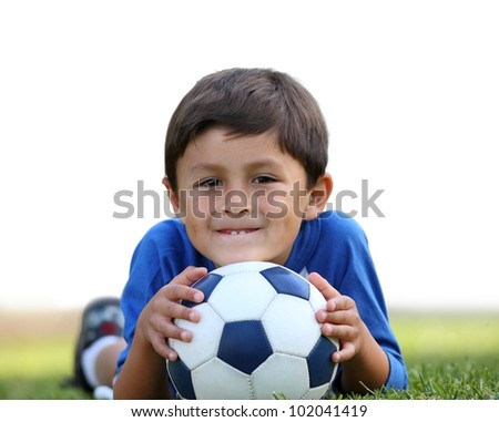 Young hispanic boy with soccer ball with partial isolation on white background - stock photo
