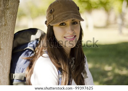 Young hispanic brunette smiling and happy relaxing on a hiking trip