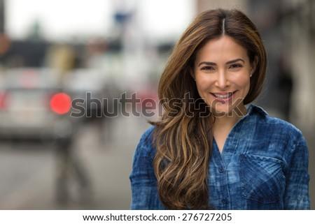 Young Hispanic caucasian woman smile happy face portrait - stock photo