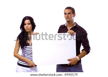 Young hispanic couple holding a blank banner - isolated over white