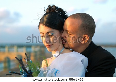Young hispanic couple on wedding day outdoors - just married - stock photo
