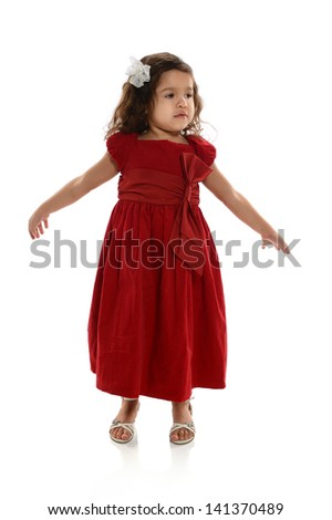 Young Hispanic girl dancing isolated over white background
