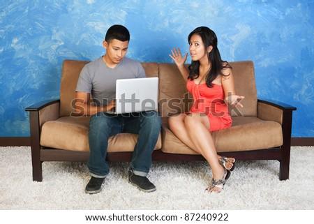 Young Hispanic girl with man on computer - stock photo
