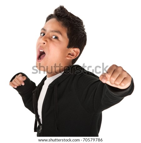 Young Hispanic kid showing fist and ready to fight on white background - stock photo