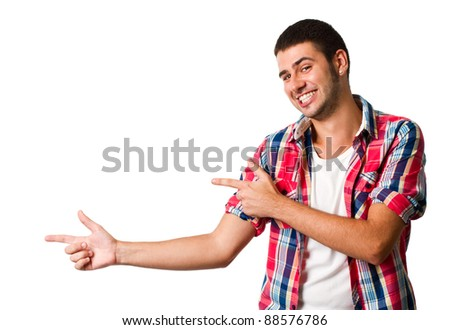 Young hispanic man pointing to blank copyspace