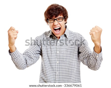 Young hispanic man wearing blue checkered shirt and black glasses screaming and celebrating win with raised fists isolated on white background - success concept - stock photo