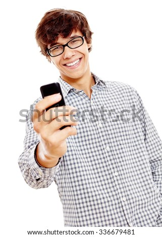 Young hispanic man wearing wearing blue checkered shirt and black glasses reading something funny from his mobile phone and smiling isolated on white background - humor and communication concept