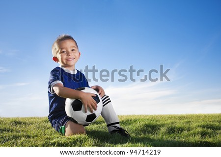 Young hispanic soccer player smiling - stock photo