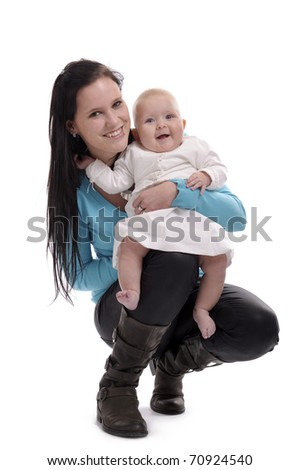 young hispanic woman holding a baby. Isolated on white