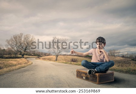 Young hitch hiker  - stock photo