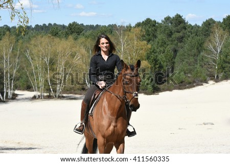 young horse rider in forest
