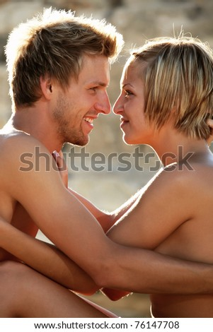 Young hot couple on the beach
