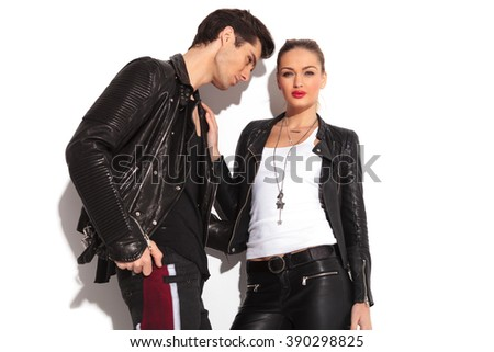young hot rock and roll couple, man holding his lover by her waist