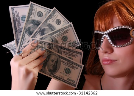 Young hot woman with dollars and sun glasses on black background - stock photo