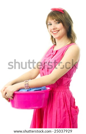 young housewife dressed in pink dress with a basin full of clothes