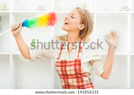 Young housewife enjoys in cleaning,Cheerful housewife - stock photo