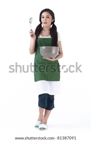 Young housewife holding a bowl and a spaghetti scoop - stock photo