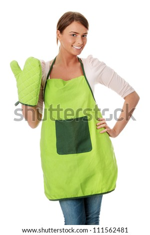 Young housewife in apron, isolated on white background - stock photo