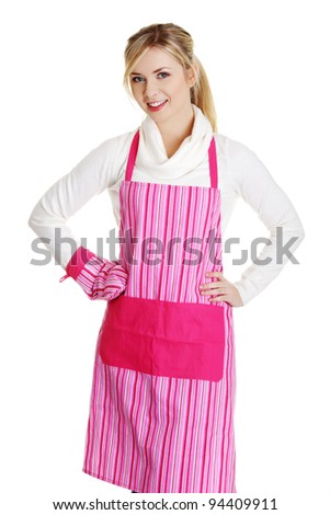 Young housewife in pink apron, isolated on white - stock photo