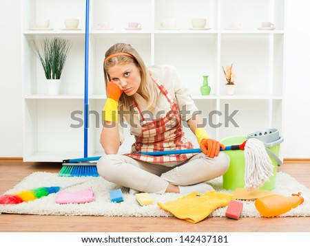 Young housewife is tired of cleaning,Fed up of cleaning - stock photo
