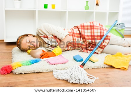 Young housewife  is very tired of housework and she is napping,Exhausted housewife - stock photo
