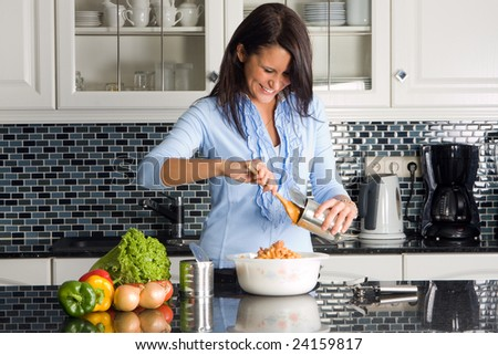 Young housewife preparing dinner out of a can - stock photo