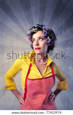 Young housewife wearing curlers - stock photo