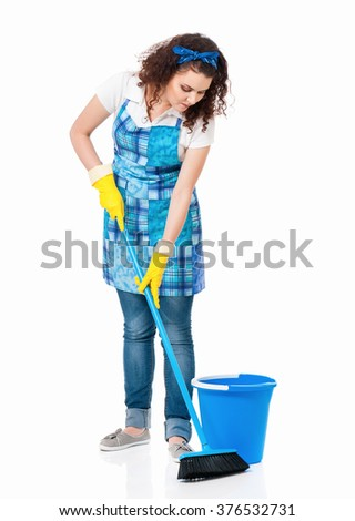 Young housewife with blue bucket and broom, isolated on white background - stock photo