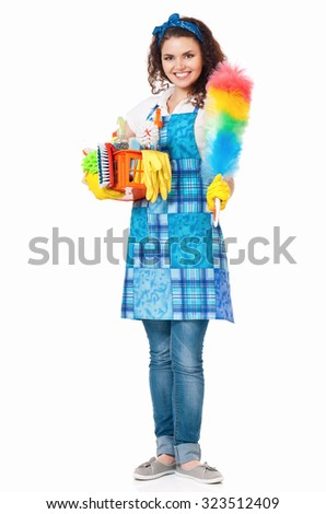 Young housewife with cleaning supplies in box, isolated on white background - stock photo