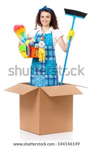 Young housewife with cleaning supplies in cardboard box, isolated on white background - stock photo