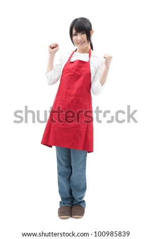 young housewife with red apron, isolated on white background - stock photo