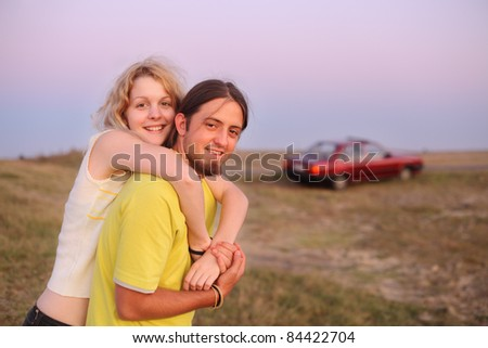 Young  hugging couple in early summer evening