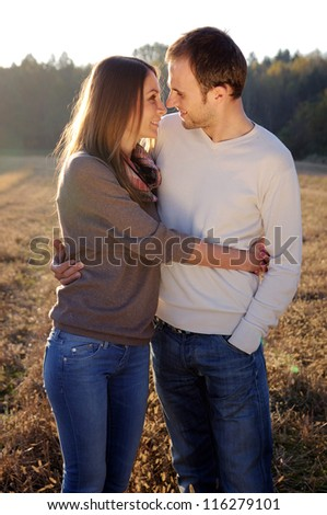 Young hugging couple in fall - stock photo
