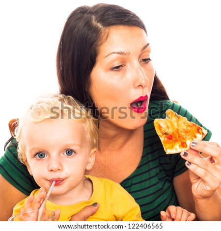 Young hungry woman eating pizza and child boy drinking, isolated on white background. - stock photo
