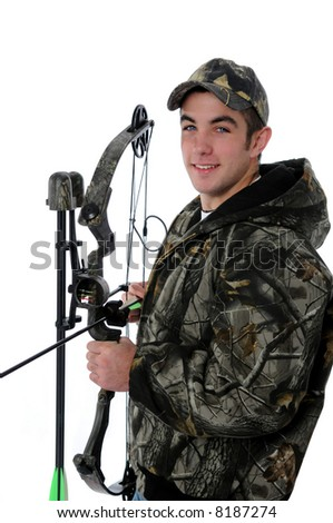 Young hunter in camouflage with bow and arrow isolated over a white background. - stock photo