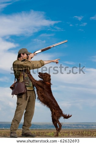 Young hunter training his dog to go for the hunt during a hunting party
