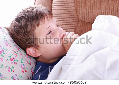Young ill child coughing in bed - stock photo
