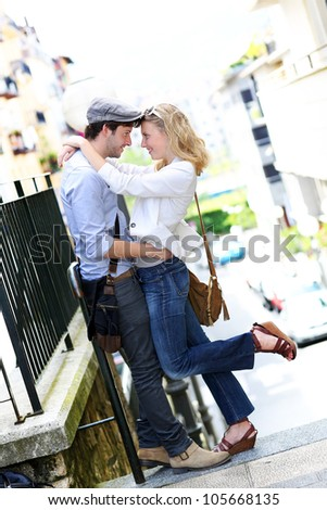 Young in love couple embracing each other in town - stock photo