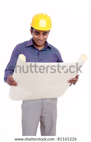 Young indian architect posing to the camera, Isolated on white background.