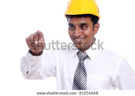 Young indian architect  posing to the camera on white background.