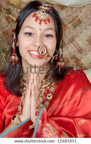 Young Indian beauty giving the Namaste greeting from India - stock photo