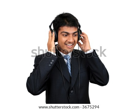Young Indian business man listening to music