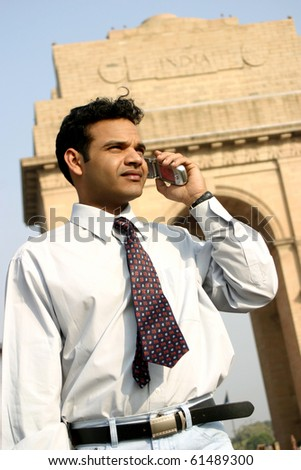 young indian business man talking on mobile - stock photo