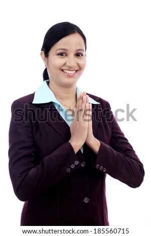 Young Indian business woman greeting Namasthe against white background