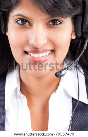 young indian business woman or telephone operator with headset - stock photo