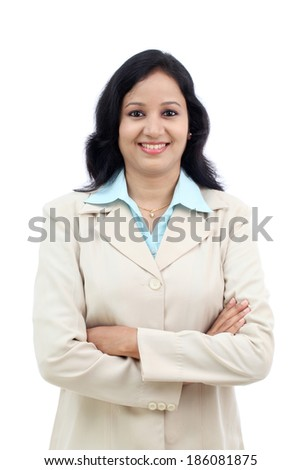 Young Indian business woman with arms crossed against white - stock photo