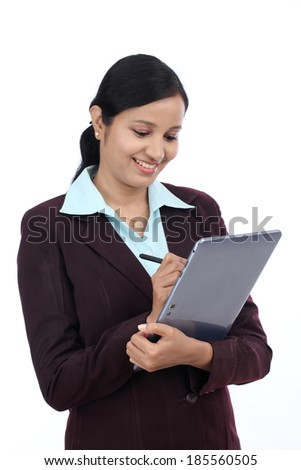 Young Indian business woman with tablet and stylus against white background