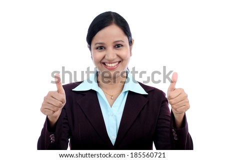 Young Indian business woman with thumbs up gesture against white - stock photo
