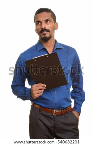 Young Indian businessman holding clipboard while thinking isolated against white background